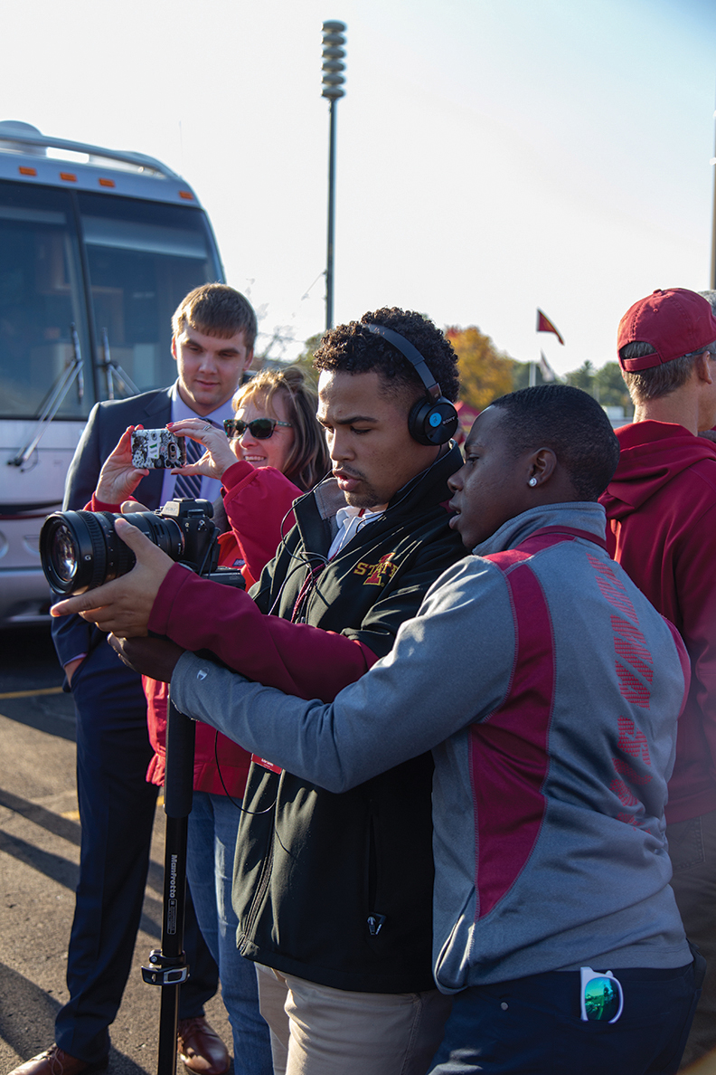Les Mwirichia and Kobe Gaines look at a camera at an Iowa State tailgate.