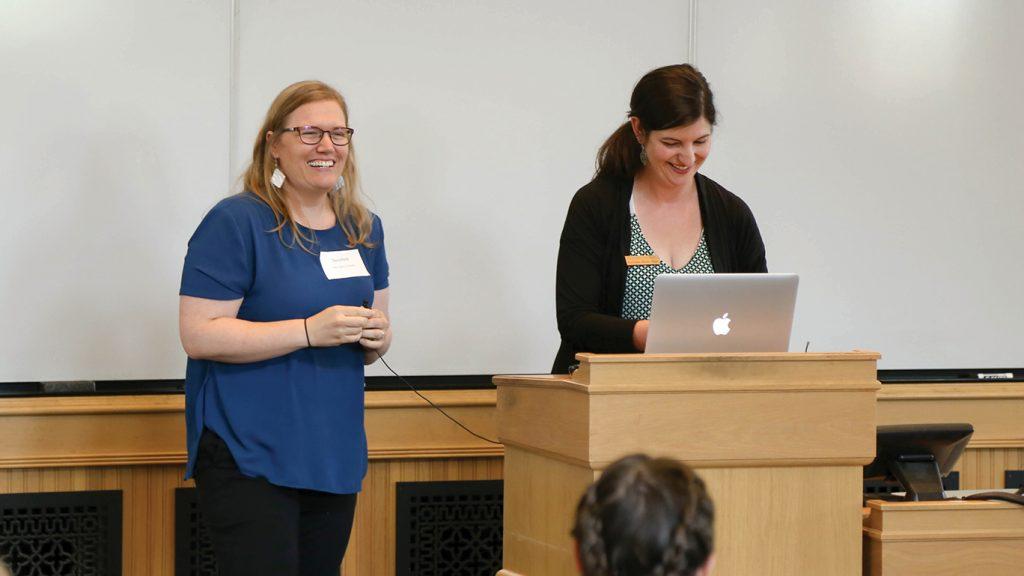 Dara Wald and Kathleen Hunt stand at the podium