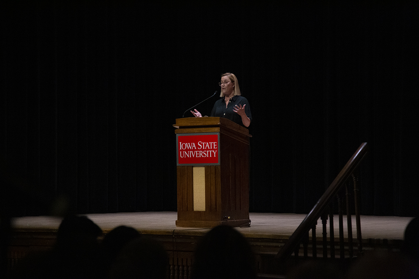 S.E. Cupp standing at the podium